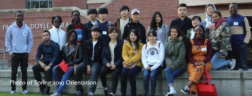 Group photo in front of Doyle Library at Spring 2019 orientation